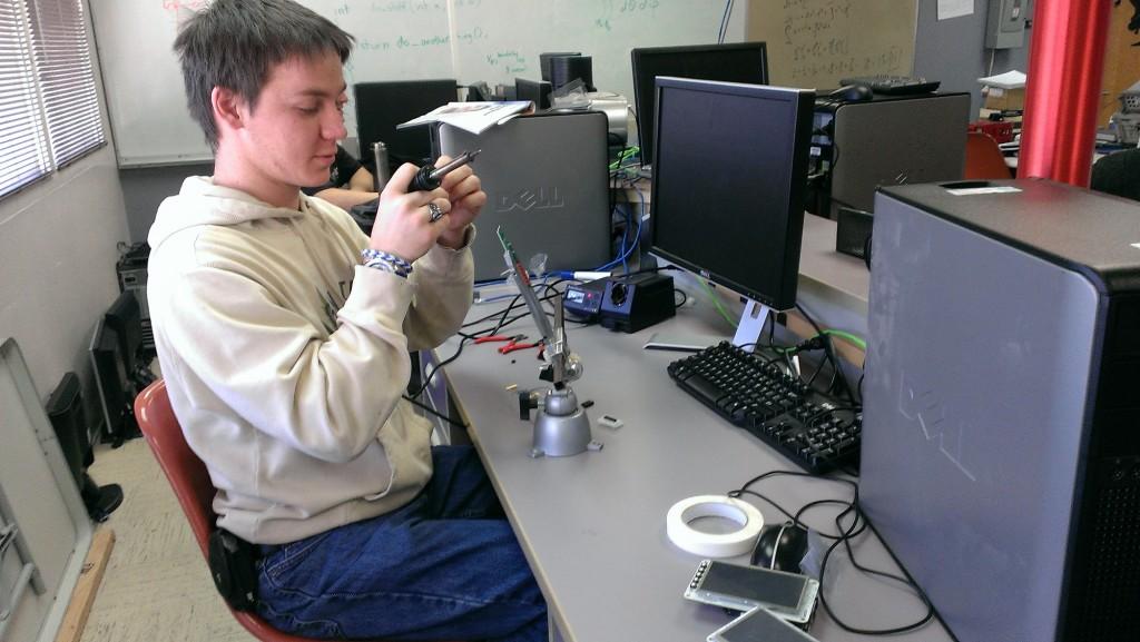 Dennis is soldering.