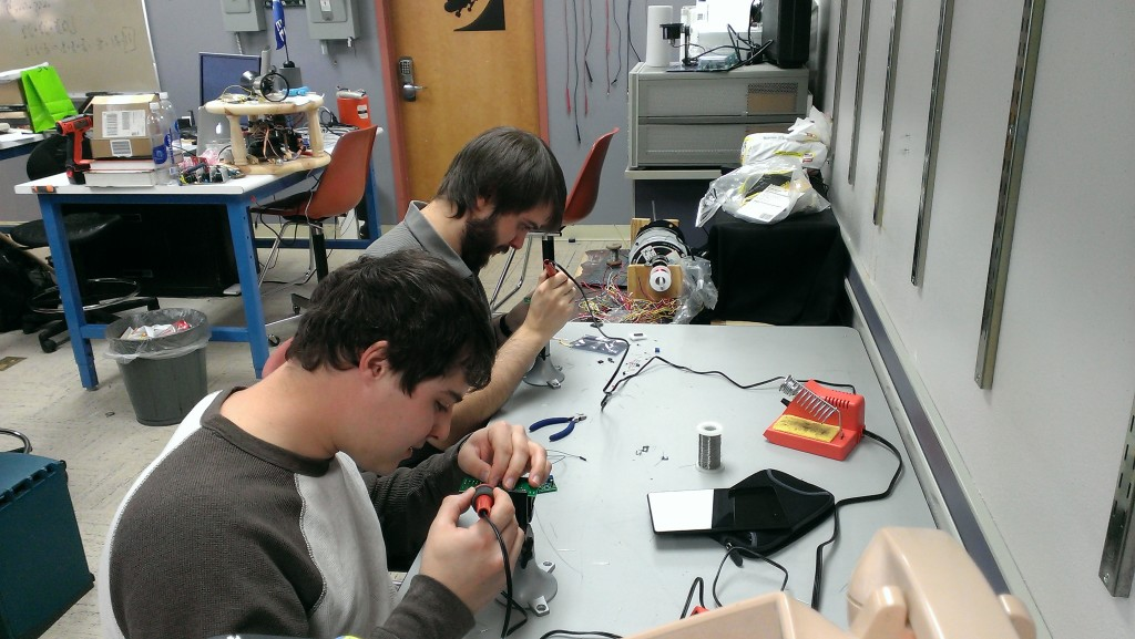 Seth Decker and Cody Shell soldering